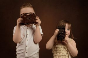 Brother and sister having Fun with cameras