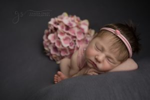 Newborn Posing with Flowers